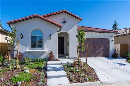 Photo of 11524 N Via Venitzia Avenue, Fresno, CA 93730 (MLS # 542921)