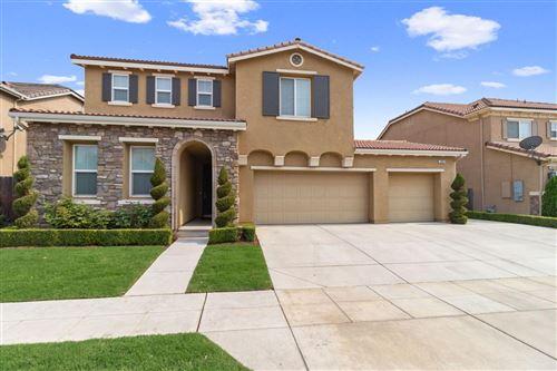 Photo of 10622 N Bonadelle Avenue, Fresno, CA 93730 (MLS # 548933)