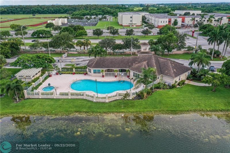 Photo of 5021 Wiles Rd #302, Coconut Creek, FL 33073 (MLS # F10250000)