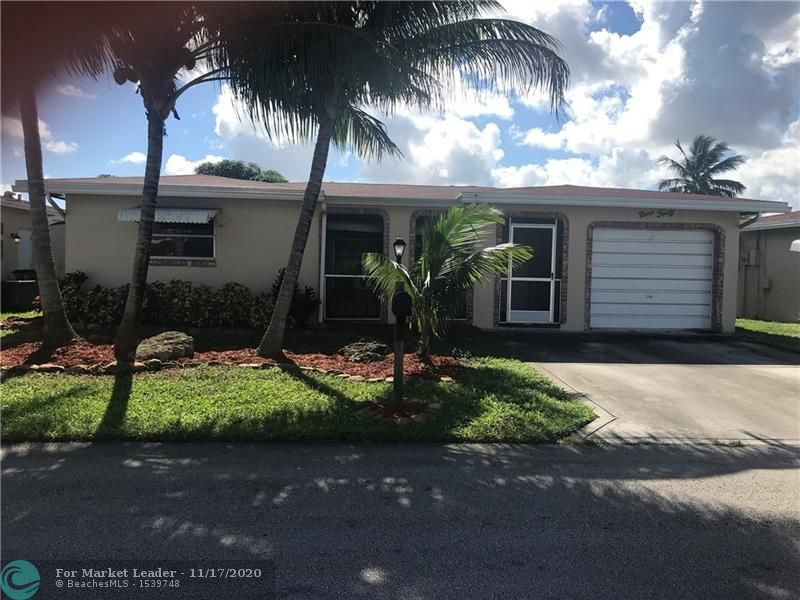 Photo of 940 NW 49 st, Deerfield Beach, FL 33064 (MLS # F10259000)