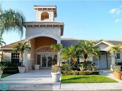Photo of 5001 Wiles Rd #104, Coconut Creek, FL 33073 (MLS # F10230003)