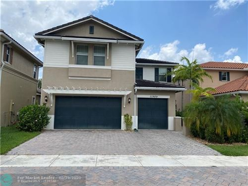 Photo of 11989 NW 83rd Pl, Parkland, FL 33076 (MLS # F10231004)
