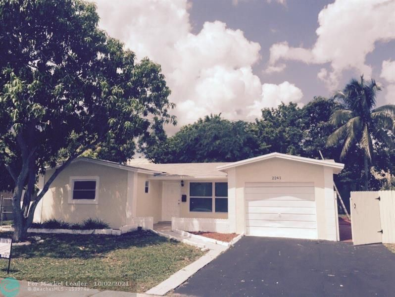 Photo of 2241 NW 51st Ave, Lauderhill, FL 33313 (MLS # F10303004)