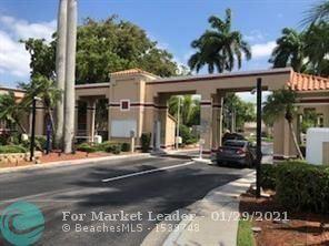 Photo of 11890 NW 11th St, Pembroke Pines, FL 33026 (MLS # F10247005)