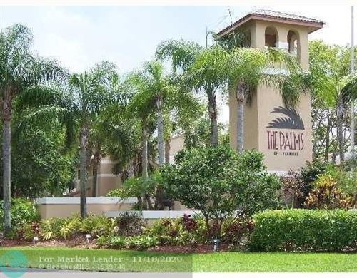 Photo of 300 Palm Cir #104, Pembroke Pines, FL 33025 (MLS # F10259013)