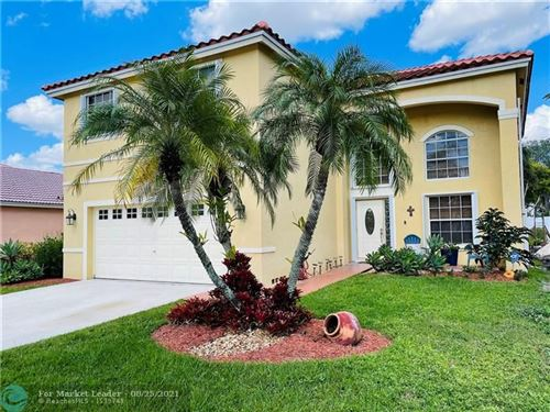 Photo of 1031 NW 187th Ave, Pembroke Pines, FL 33029 (MLS # F10295013)