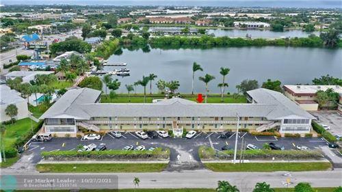 Photo of 960 Crystal Lake Dr #109, Deerfield Beach, FL 33064 (MLS # F10306014)