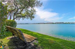Photo of 114 Lake Emerald Dr #106, Oakland Park, FL 33309 (MLS # F10202019)