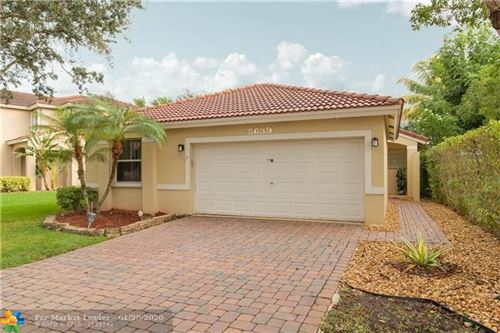 Photo of 5639 NW 122nd Ter, Coral Springs, FL 33076 (MLS # F10214020)
