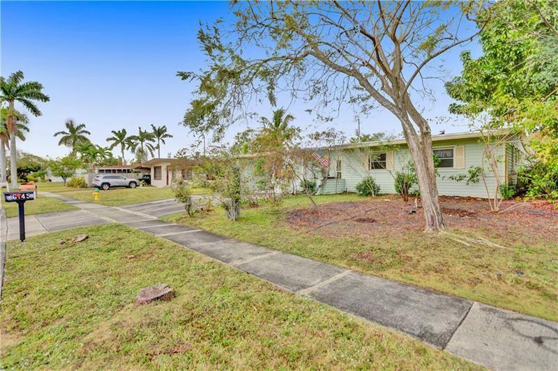 Photo of 6145 Royal Palm Blvd, Margate, FL 33063 (MLS # F10266026)