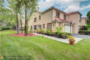 Photo of 9834 Royal Palm Blvd #4-14, Coral Springs, FL 33065 (MLS # F10185029)