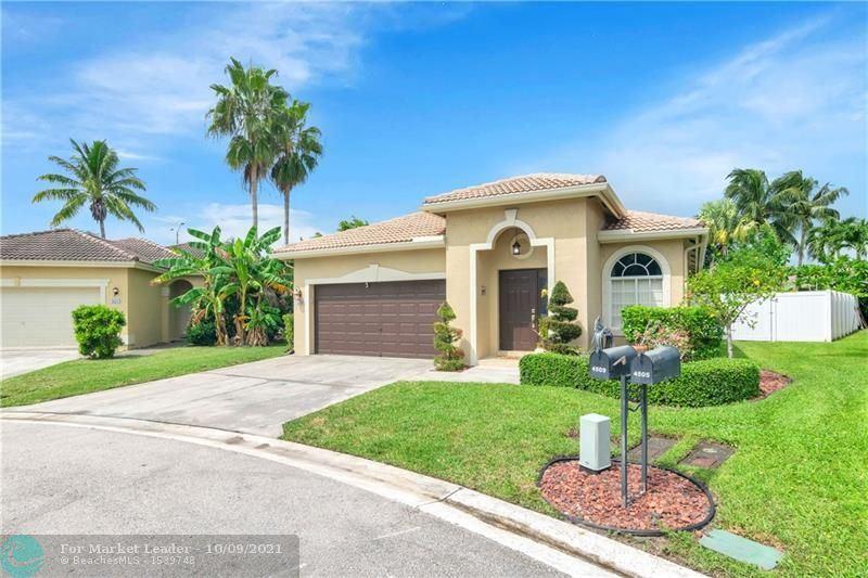 Photo of 4509 SW 13th St, Deerfield Beach, FL 33442 (MLS # F10303030)
