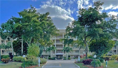 Photo of 4030 W Palm Aire Dr #205, Pompano Beach, FL 33069 (MLS # F10268031)