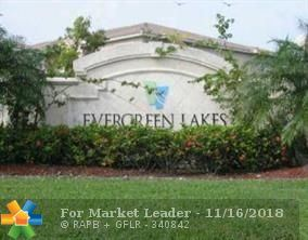 Photo of 5065 Wiles Rd #203, Coconut Creek, FL 33073 (MLS # F10150033)