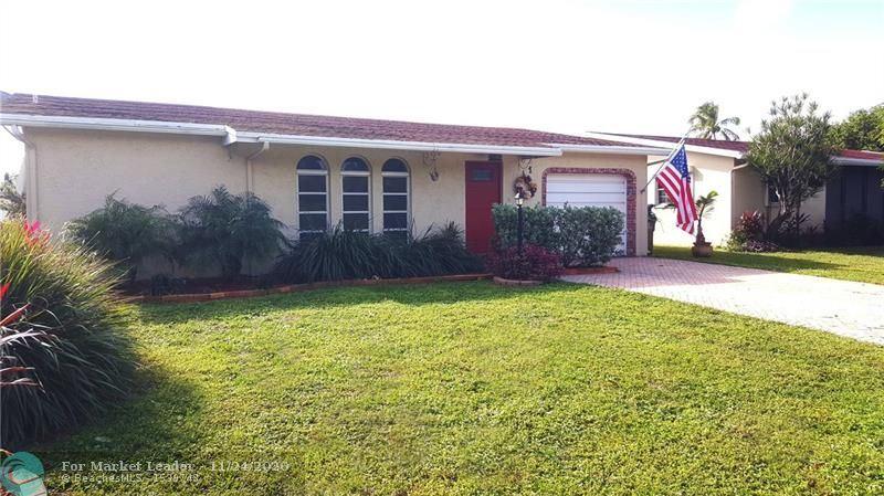 Photo of 1260 NW 49th Ct, Deerfield Beach, FL 33064 (MLS # F10260037)