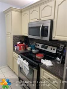 Tiny photo for 2710 Forest Hills Blvd #104, Coral Springs, FL 33065 (MLS # F10180042)