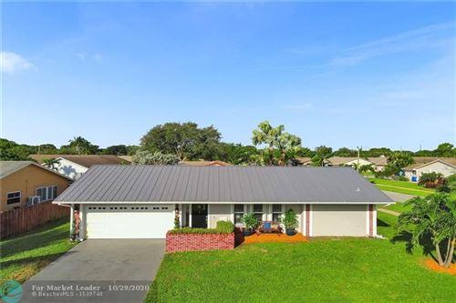 Photo of 1219 SW 26th Ave, Deerfield Beach, FL 33442 (MLS # F10256044)
