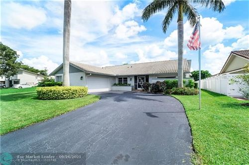 Photo of 12048 NW 27th Dr, Coral Springs, FL 33065 (MLS # F10302045)