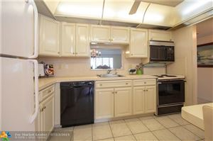 Photo of 4140 NW 44th Ave #301, Lauderdale Lakes, FL 33319 (MLS # F10179049)
