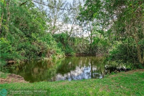 Photo of 6970 NW 83rd Ter, Parkland, FL 33067 (MLS # F10282054)