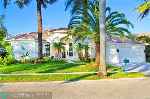 Photo of 2525 Montclaire Cir, Weston, FL 33327 (MLS # F10231055)