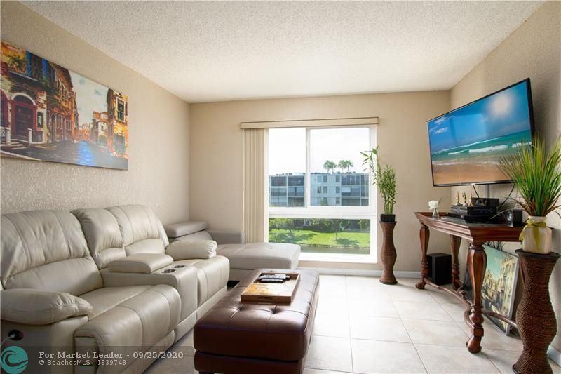 Photo of 2106 S Cypress Bend Dr #407, Pompano Beach, FL 33069 (MLS # F10250055)