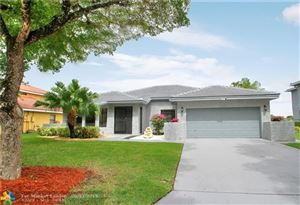 Photo of 6377 NW 50th St, Coral Springs, FL 33067 (MLS # F10168056)
