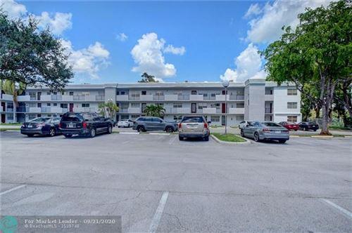Photo of 8405 NW 61st St #D311, Tamarac, FL 33321 (MLS # F10250057)