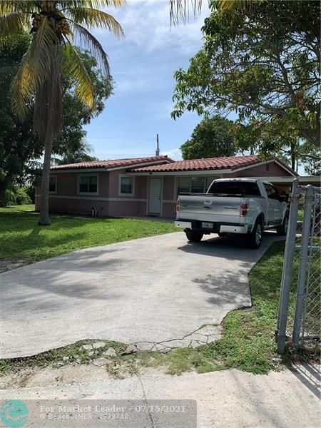 Photo of 1637 NW 11th Ave, Fort Lauderdale, FL 33311 (MLS # F10293057)