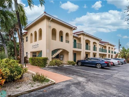 Photo of 4611 Poinciana St #1, Lauderdale By The Sea, FL 33308 (MLS # F10250061)
