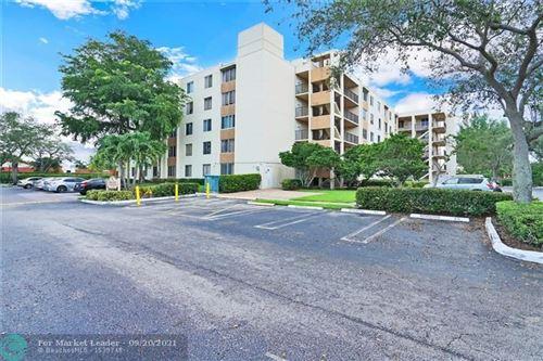 Photo of 3205 Riverside Dr #c-304, Coral Springs, FL 33065 (MLS # F10301064)