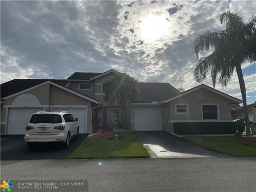 Photo of 1245 W Lakes Dr, Deerfield Beach, FL 33442 (MLS # F10205066)