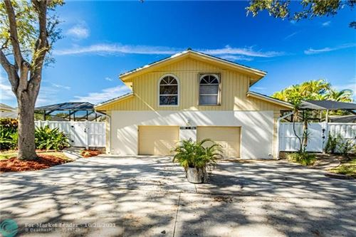 Photo of 5198 Woodruff Lane, Palm Beach Gardens, FL 33418 (MLS # F10306067)