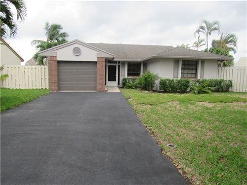 Photo of 931 Seabrook Ave, Davie, FL 33325 (MLS # F10274072)