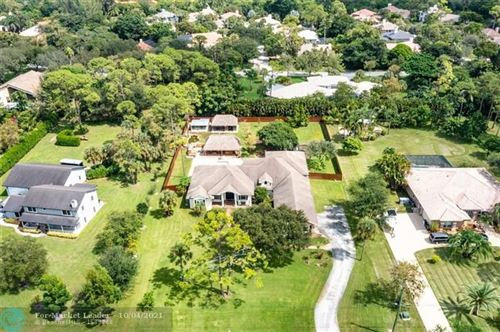 Photo of 6924 NW 62nd Ter, Parkland, FL 33067 (MLS # F10303076)