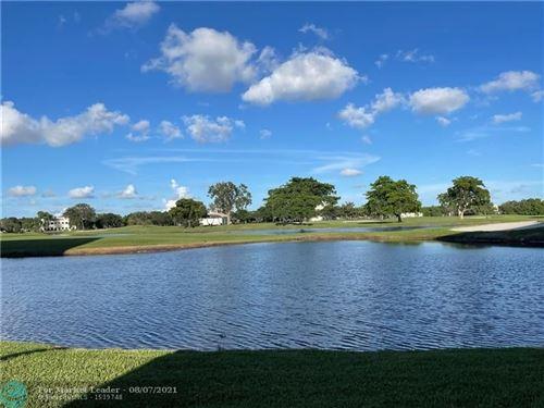 Photo of 3150 W Rolling Hills Cir #301, Davie, FL 33328 (MLS # F10296079)