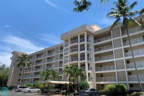 Photo of 2651 S Course Dr #608, Pompano Beach, FL 33069 (MLS # F10268082)