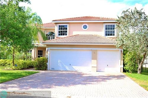 Photo of 11575 NW 51st Pl, Coral Springs, FL 33076 (MLS # F10230085)