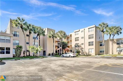Photo of 9431 Live Oak Pl #108, Davie, FL 33324 (MLS # F10213086)