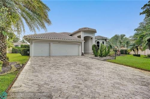 Photo of 6531 NW 98th Dr, Parkland, FL 33076 (MLS # F10237086)
