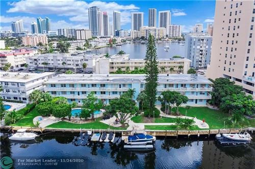 Photo of 455 Golden Isles Dr #208, Hallandale, FL 33009 (MLS # F10260086)