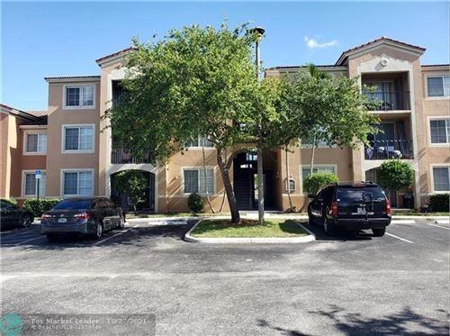 Photo of 7980 N Nob Hill Rd #103, Tamarac, FL 33321 (MLS # F10306086)