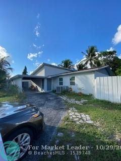 Photo of 7693 Forest Blvd, North Lauderdale, FL 33068 (MLS # F10303086)