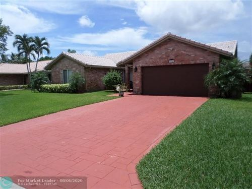 Photo of 654 NW 111th Ter, Coral Springs, FL 33071 (MLS # F10242094)