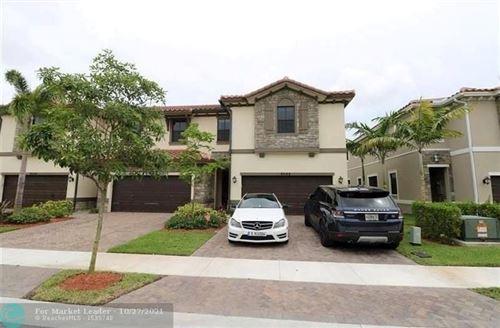Photo of 9586 Town Parc Cir #9586, Parkland, FL 33076 (MLS # F10306094)