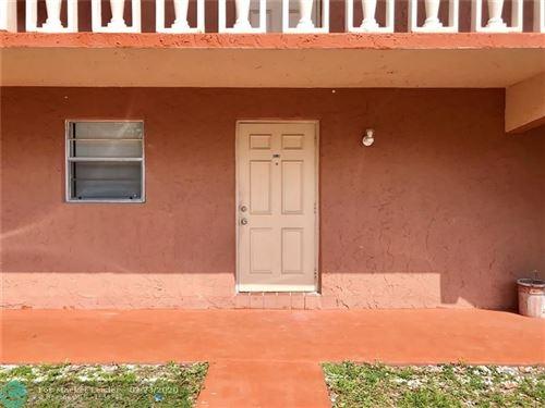 Photo of 7830 NW 33rd St #104, Davie, FL 33024 (MLS # F10218095)