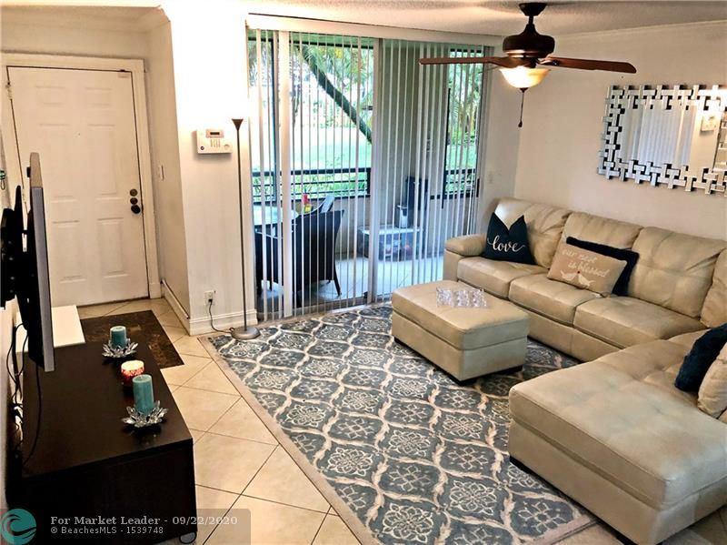 Photo of 721 Lyons Rd #15104, Coconut Creek, FL 33063 (MLS # F10250097)