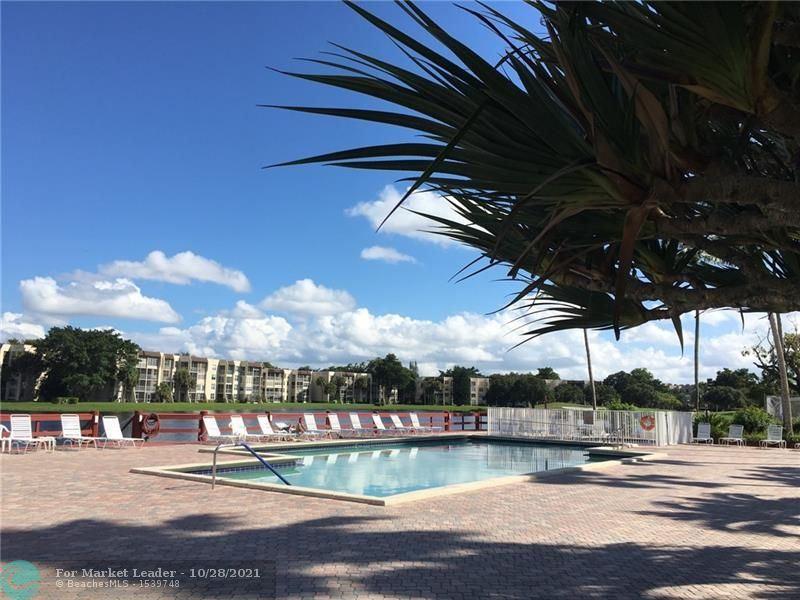 Photo of 9480 Poinciana Pl #305, Davie, FL 33324 (MLS # F10306099)