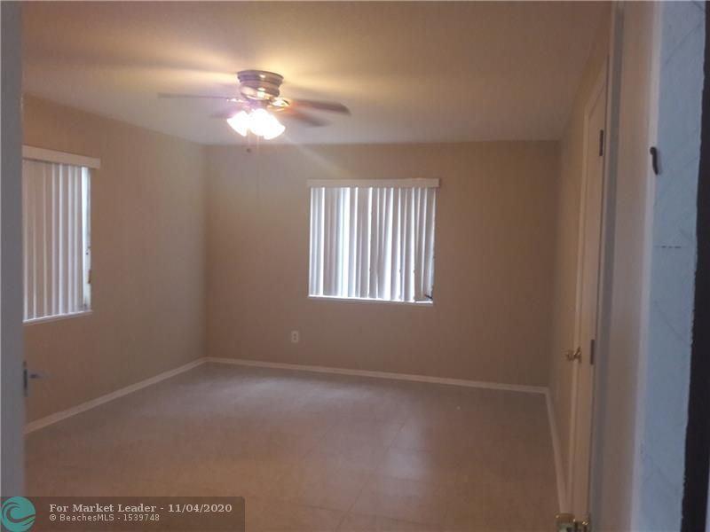 Photo of 547 W 3rd, Riviera Beach, FL 33404 (MLS # F10257105)