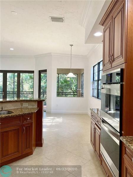Photo of 7574 Old Thyme Ct, Parkland, FL 33076 (MLS # F10250109)